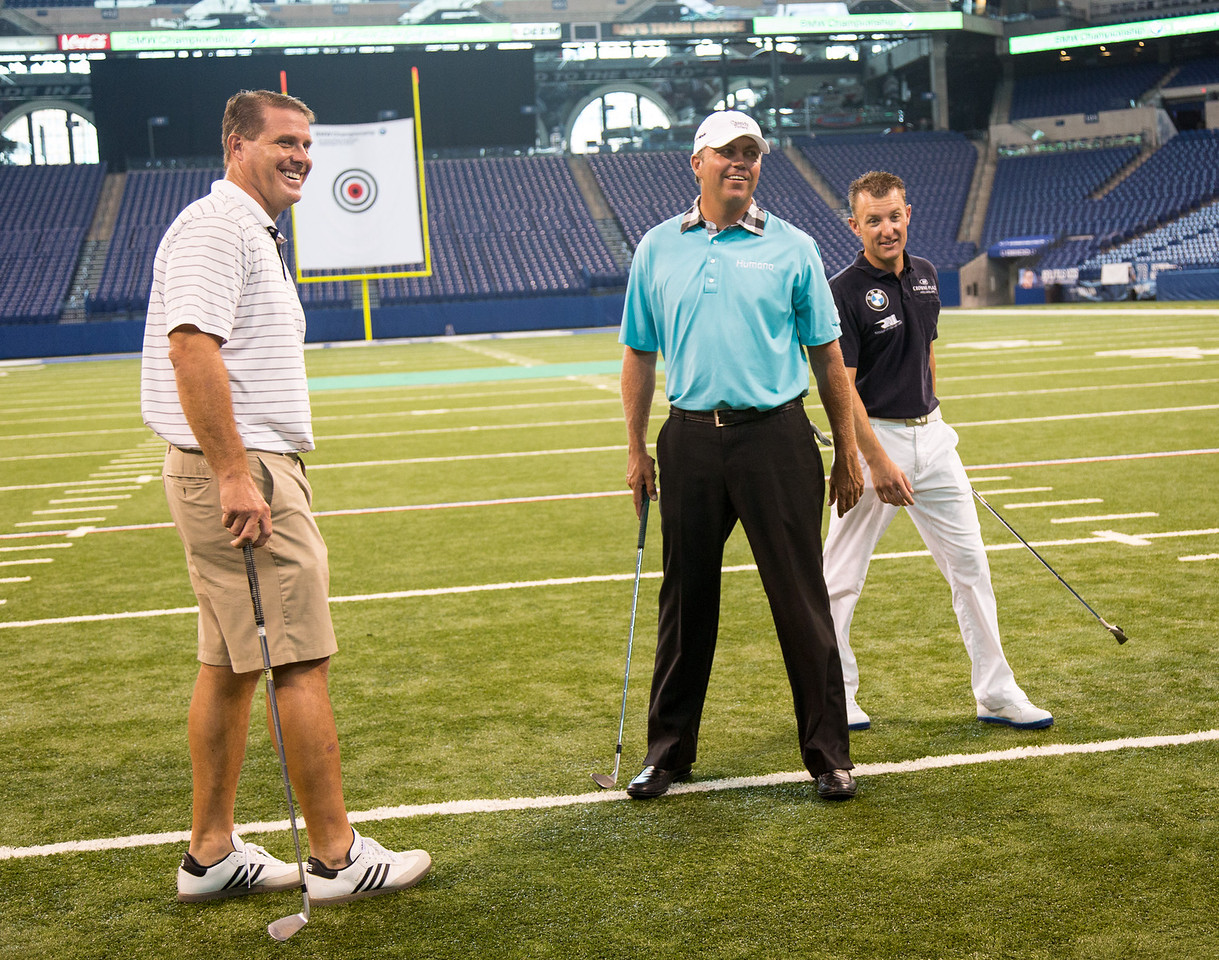 Former Colts TE Ken Dilger, PGA TOUR Pro Bo Van Pelt and BMW ALMS Champion Driver Joey Hand, kicked-off the 2012 BMW Championship by attempting to hit a golf ball though a 12-inch hole in a 19-foot by 22-foot target hung between the uprights inside the Colts' Lucas Oil Stadium in Indianapolis Tuesday, September 4, 2012. The group was on hand to raise money for the Evans Scholars Foundation, the nation's largest privately funded college tuition and housing scholarship program. All proceeds of the BMW Championship, the third leg in the PGA TOUR playoffs for the FedExCup, benefit the Evans Scholars (WGA Photo/Charles Cherney).