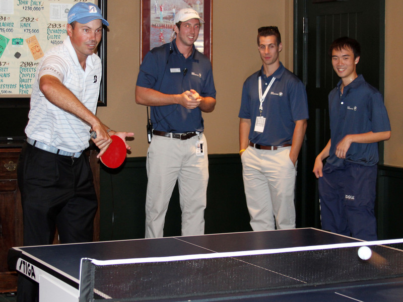 Matt Kuchar tries to impress United States ping pong Olympian Timothy Wang and BMW representatives in the players clubhouse while waiting out a rain delay during the pro am at Crooked Stck golf course in Carmel Indiana on Wed. Sept. 5, 2012 (Ian Yelton/WGA).