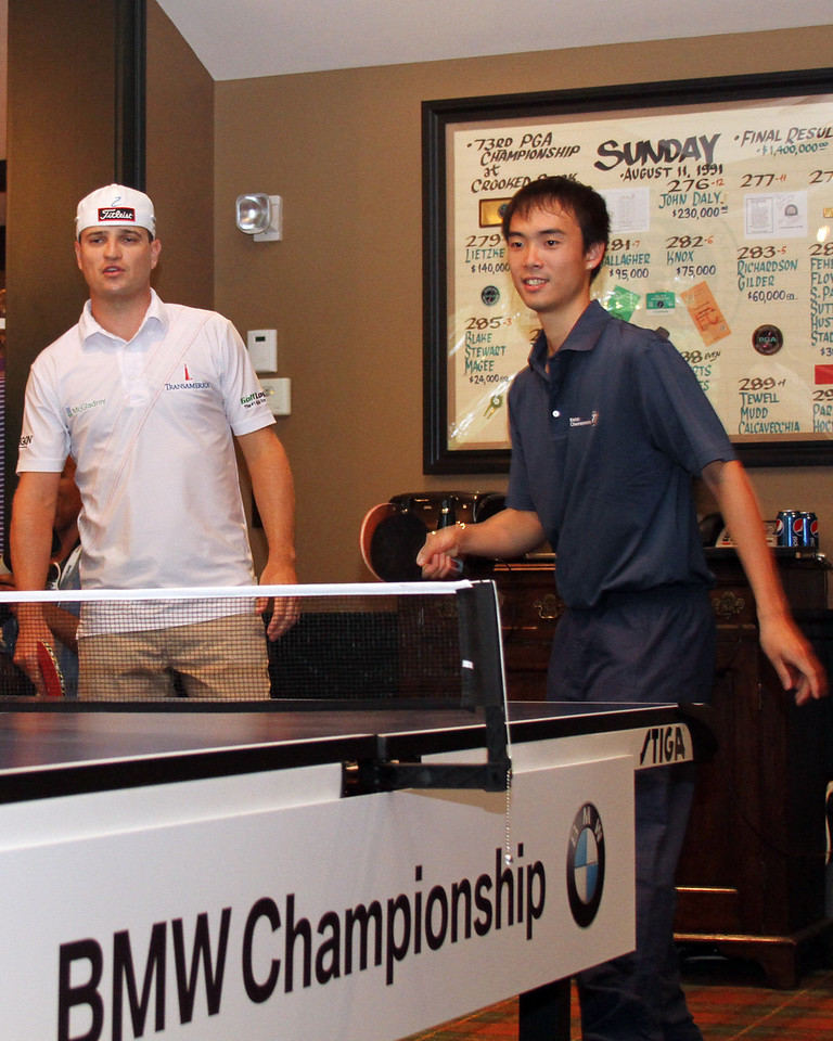 Zach Johnson paired up with United States ping pong Olympian Timothy Wang and took on Phil Mickelson and Matt Kuchar in a ping pong match in the players clubhouse while waiting out a rain delay during the pro am at Crooked Stck golf course in Carmel Indiana on Wed. Sept. 5, 2012 (Ian Yelton/WGA).