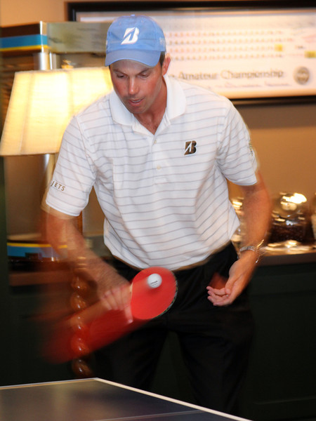 Matt Kuchar dishes out a serve sends back a serve in a friendly ping pong match while waiting out a rain delay during the Pro-Am on Wed. September 5, 2012 at Crooked Stick Golf Club in Indiana (Ian Yelton/WGA) edit