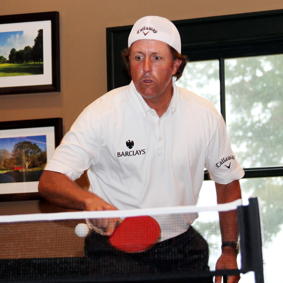 Phil Mickelson playing in a friendly ping pong match while sticking out a rain delay during the Pro-Am on Wed. September 5, 2012 at Crooked Stick Golf Club in Indiana (Ian Yelton/WGA)