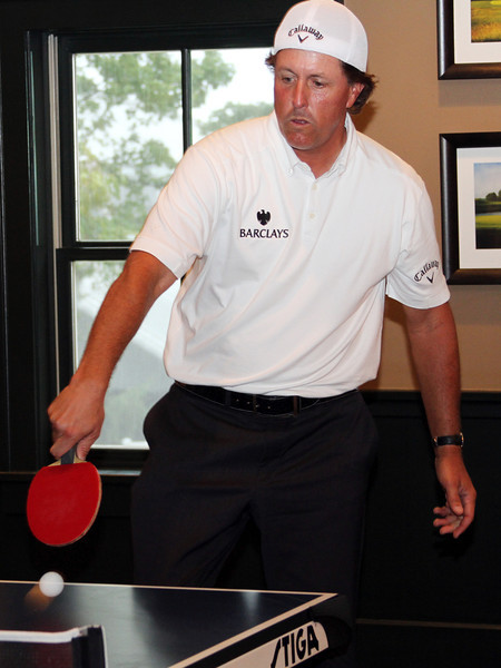 Phil Mickelson sends back a serve from Matt Kuchar in a friendly ping pong match while sticking out a rain delay during the Pro-Am on Wed. September 5, 2012 at Crooked Stick Golf Club in Indiana (Ian Yelton/WGA)
