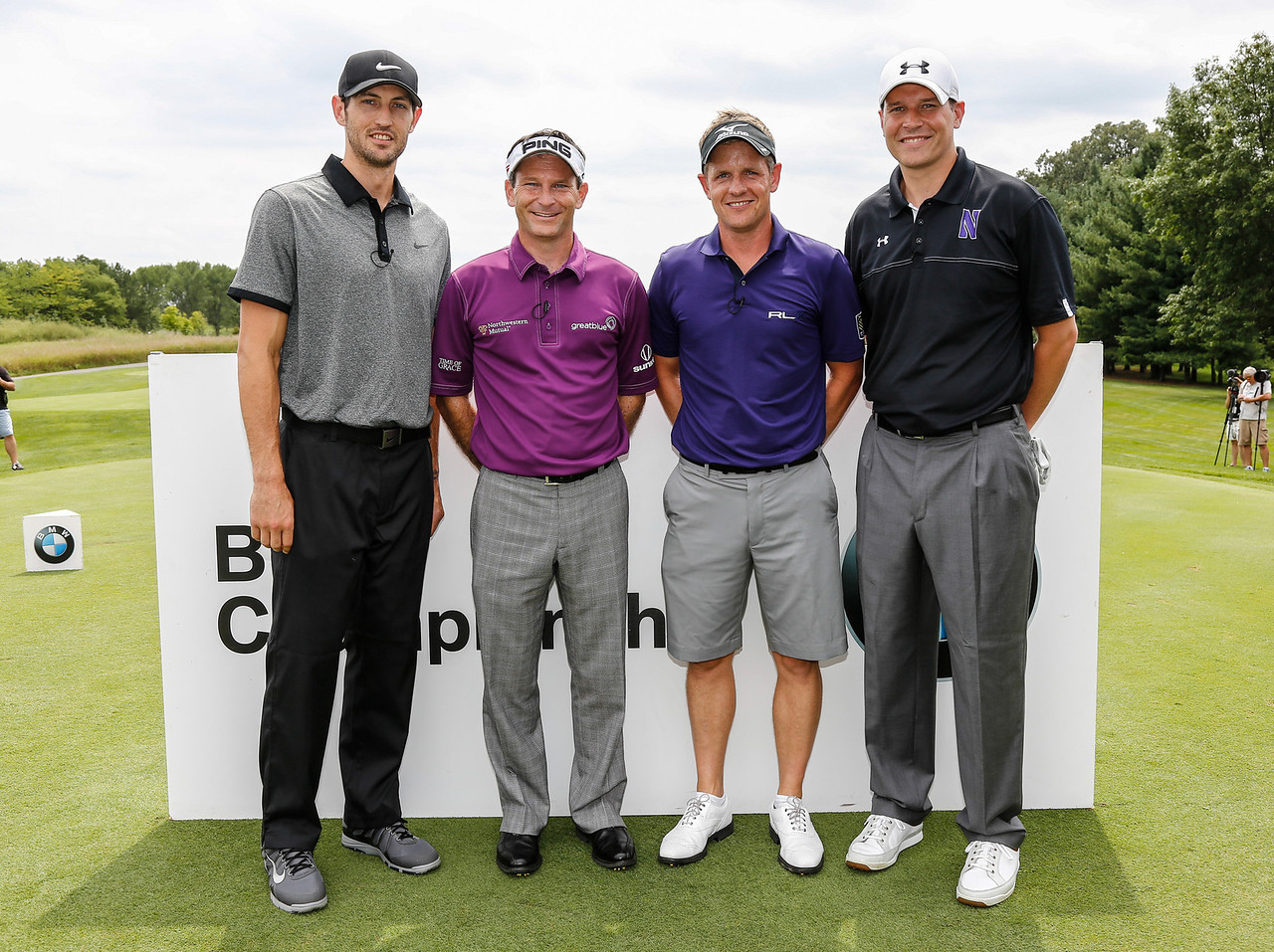 Kirk Hinrich, Mark Wilson, Luke Donald and Chris Collins take a second to pose for a photo before they teed off in the 2013 BMW Championship Exhibition at Conway Farms Golf Club on Monday, Aug. 12. The nine-hole exhibition raised $45,000 for the Evans Scholars Foundation, the sole beneficiary of the BMW Championship. The BMW Championship, the third of four events in the PGA TOUR's FedExCup Playoffs, will be held the week of Sept. 9-15 at Conway Farms. WGA Photo/Charles Cherney)