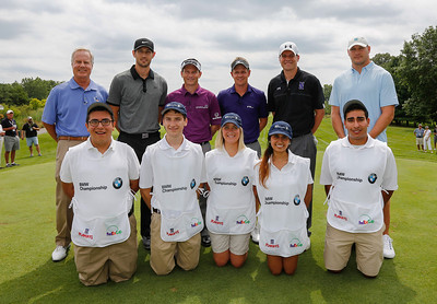 Mark Rolfing, Kirk Hinrich, Mark Wilson, Luke Donlad, Chris Collins and Brian Urlacher pose with Evans Scholars  Sergio DeLeon, Brandon Clarke, Mary Kate McGovern, Yesenia Juarez and Mark Abtahi before the start of the BMW Championship Exhibition at Conway Farms Golf Club on Monday, Aug. 12. The nine-hole exhibition raised $45,000 for the Evans Scholars Foundation, the sole beneficiary of the BMW Championship.  The BMW Championship, the third of four events in the PGA TOUR's FedExCup Playoffs, will be held the week of Sept. 9-15 at Conway Farms. WGA Photo/Charles Cherney)