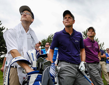 Evans Scholar Brandon Clarke, Luke Donald and Mark Wilson watch a tee shot soar through the air during the BMW Championship Exhibition at Conway Farms Golf Club on Monday, Aug. 12. The nine-hole exhibition raised $45,000 for the Evans Scholars Foundation, the sole beneficiary of the BMW Championship.  The BMW Championship, the third of four events in the PGA TOUR's FedExCup Playoffs, will be held the week of Sept. 9-15 at Conway Farms. WGA Photo/Charles Cherney)