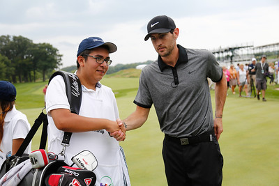 Kinrik Hinrich gives Evans Scholar Sergio DeLeon a handshake following his nine-hole loop at the BMW Championship Exhibition at Conway Farms Golf Club on Monday, Aug. 12. The nine-hole exhibition raised $45,000 for the Evans Scholars Foundation, the sole beneficiary of the BMW Championship.  The BMW Championship, the third of four events in the PGA TOUR's FedExCup Playoffs, will be held the week of Sept. 9-15 at Conway Farms. WGA Photo/Charles Cherney)