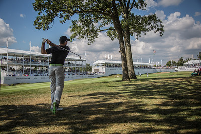 Sergio Garcia hits his third shot from behind a tree on the 18th hole during the first round of the 2013 BMW Championship at Conway farms in Lake Forest IL on Thursday Sept. 12, 2011. WGA/Charles Cherney