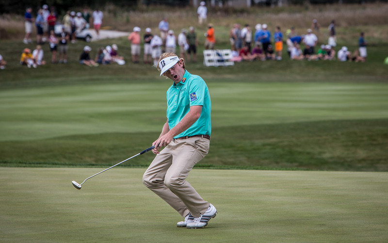 Brandt Snedeker reacts after missing a birdie putt on the 8th hole during the opening round at the BMW/Western Open on Thurs. Sept. 12, 2013. WGA Photo/Charles Cherney