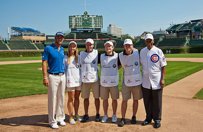 Professional golfer Dustin Johnson, Evans Scholars and Ernie Banks at Wrigley Field Monday of the BMW Championship.