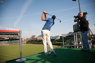 Defending Champion Dustin Johnson hits out into right field at The Friendly Confines