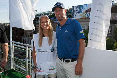 Northwestern Evans Scholar Chapter President Katie Johnson with pro-golfer Dustin Johnson.
