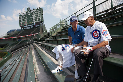 Dustin Johnson and former Cubs shortstop and first baseman Ernie Banks at Wrigley Field.