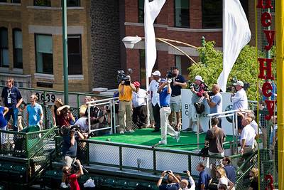 Camera crews gather to watch BMW Championship defending champion Dustin Johnson tee off a platform at Wrigley Field.