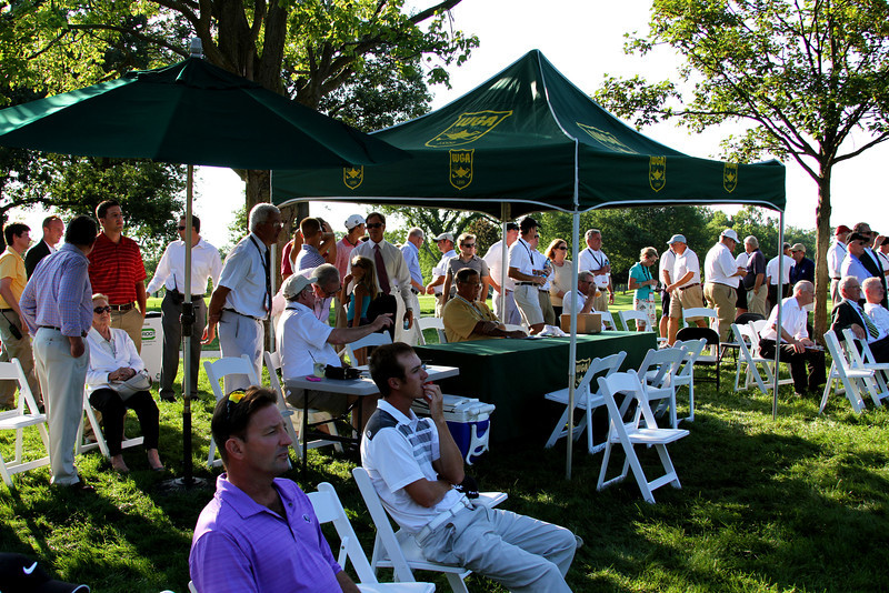 Spectators look over the 18th green at North Shore Country Club on Thursday.