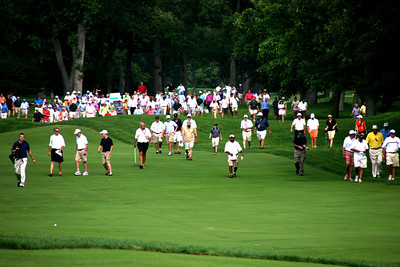 A large crowd follows Friday's afternoon match between Nos. 1 and 2 ranked Amateurs Patrick Cantlay and Peter Uihlein.