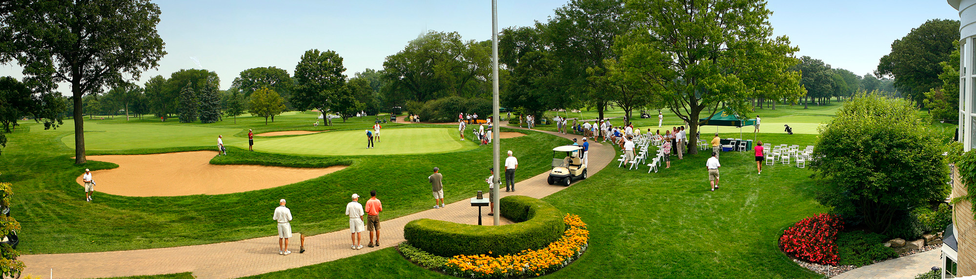 Panoramic view of the 9th green (L) and 18th green (R) of the North Shore CC.