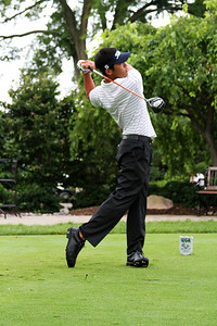 Jeffrey Kang, 20, of Fullerton, Calif., tees off in his match against John Hahn Friday morning.