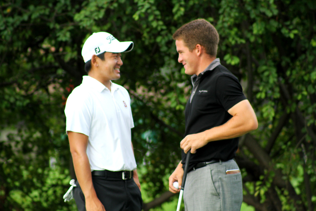 Top Amateur golfers Andrew Yun, 20, of Chandler, Ariz., and John Hahn, 22, of Hudson, Ohio, talk on the tee before beginning their third round Thursday.