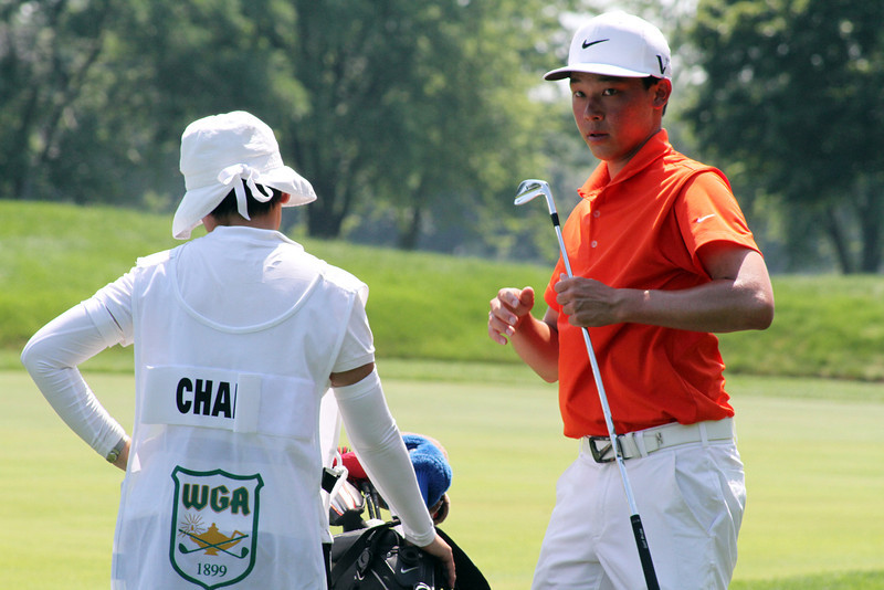 Lorens Chan of Honolulu, Hawaii gets some advice from his mother towards the end of his opening match at the 2012 Western Amateur Championship at Exmoor Country Club in Highland Park, IL on Friday, Aug. 3, 2012. (WGA Photo/Ian Yelton)