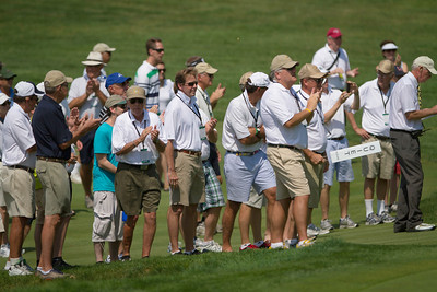 Spectators applaud a sand shot by Peter Williamson during the semifinals of match play competition at the 2012 Western Amateur Championship at Exmoor Country Club in Highland Park Ill., on Saturday, August 4, 2012. (WGA Photo/Charles Cherney)