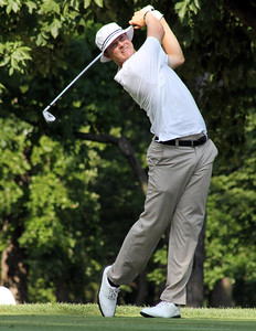 Semifinalst Jordan Russell follows through on one of the par 3's during his semifinal match of the 2012 Western Amateur at Exmoor Country Club in Highland Park IL. on Aug. 4, 2012. (WGA Photo/Ian Yelton)