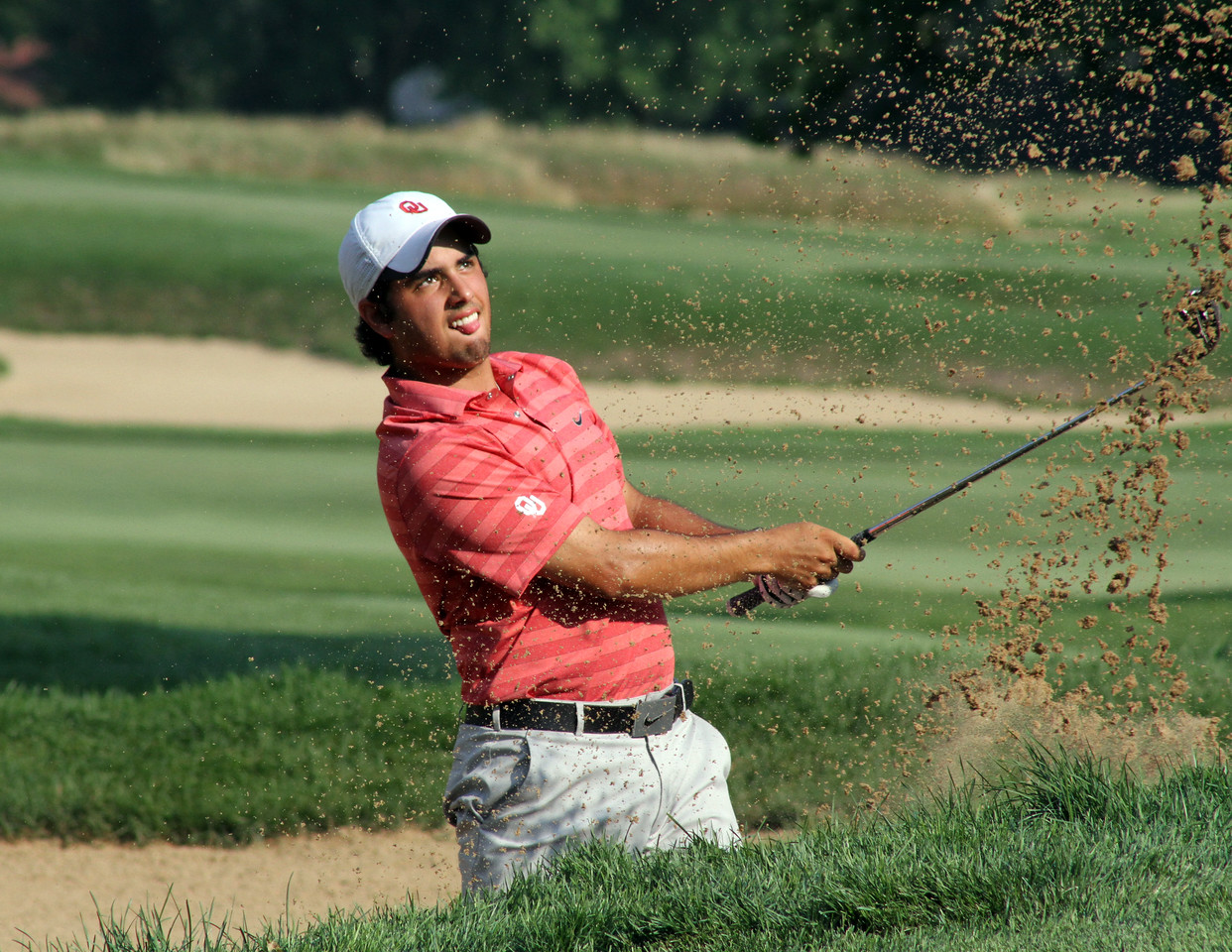 Semifinalist Abraham Ancer does his best Michael Jordan impression out of the bunker during his semifinal match at the 2012 Western Amateur at Exmoor Country Club in Highland Park IL. on Aug. 4, 2012. (WGA Photo/Ian Yelton)