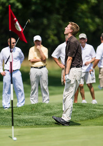 Peter Williamson reacts after missing a birdie chip on the second playoff hole against Jordan Russell in the semifinals of match play competition at the 2012 Western Amateur Championship at Exmoor Country Club in Highland Park Ill., on Saturday, August 4, 2012. (WGA Photo/Charles Cherney)