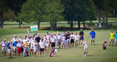 Crowd watches Chris Williams hit his approach shot to the 18th green during the semi-finals of match play competition at the 2012 Western Amateur Championship at Exmoor Country Club in Highland Park IL. on Saturday, August 4, 2012. (WGA Photo/Charles Cherney)