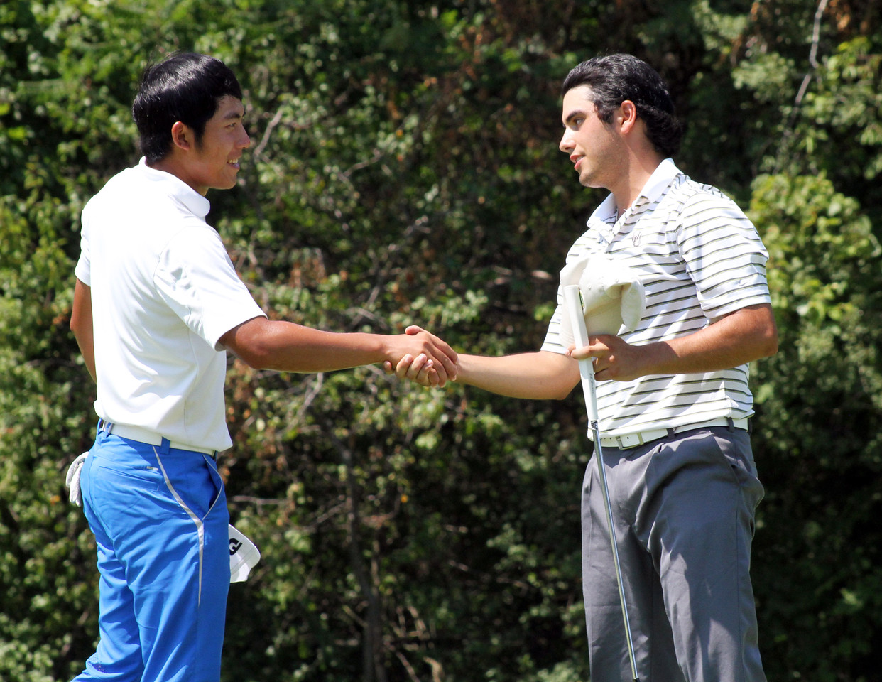Cheng-Tsung Pan of Taiwan and Abraham Ancer of Mission, Texas shake hands after the 20th hole of their opening match at the 2012 Western Amateur Championship at Exmoor Country Club in Highland Park, IL on Friday, Aug. 3, 2012. (WGA Photo/Ian Yelton)
