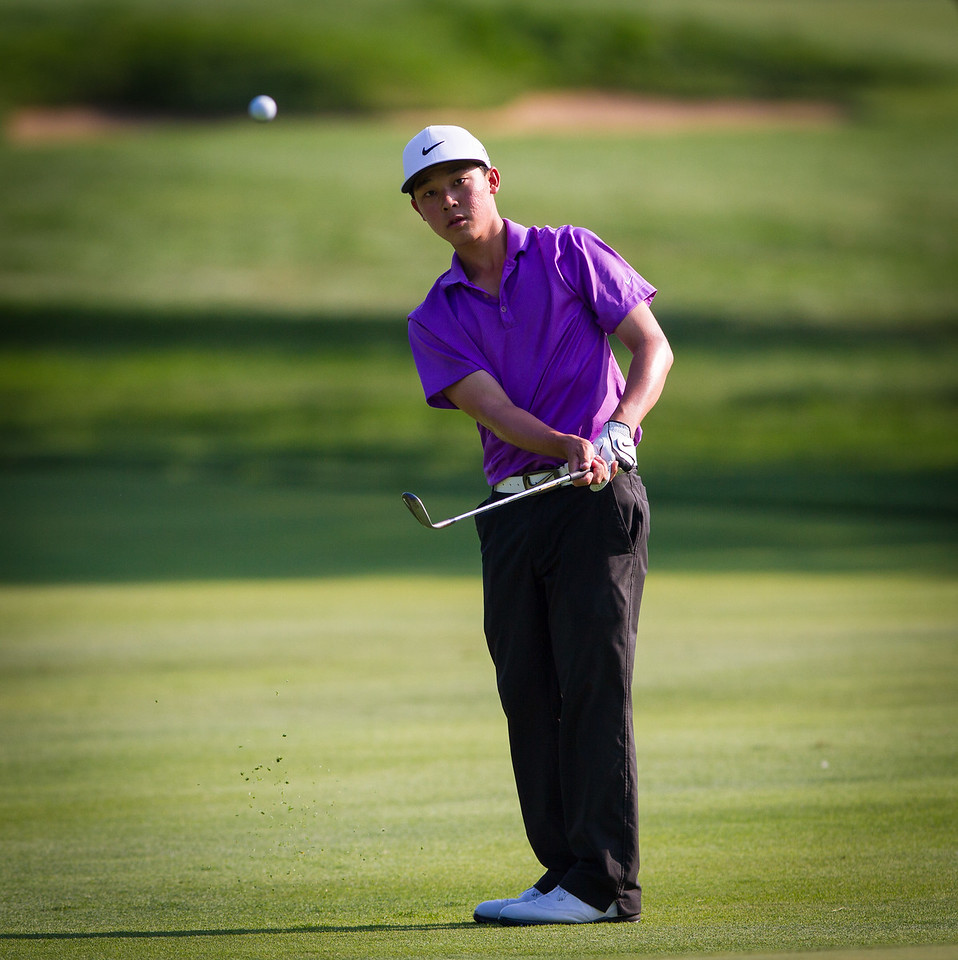 Lorens Chan hits his approach shot to the 15th green during the final round round of medal play at the 2012 Western Amateur Championship at Exmoor Country Club in Highland Park IL. on Thursday, August 2, 2012.. (WGA Photo/Charles Cherney)