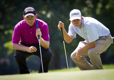 Co-leader Matthew Stieger (L) of Narrabri, Australia, and Bobby Wyatt of Mobile AL. look over their putts on the 6th hole during first round medal play at the 2012 Western Amateur Championship. Stieger is tied for the lead with Alex Moon at Exmoor Country Club in Highland Park IL. on Tuesday, July 31, 2012. (WGA Photo/Charles Cherney)