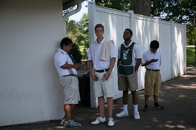 Caddies wait to be called into action during first round medal play at the 2012 Western Amateur Championship at Exmoor Country Club in Highland Park IL. on Tuesday, July 31, 2012. (WGA Photo/Charles Cherney)