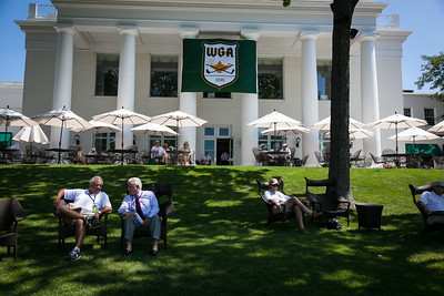 Spectators sit outside of the clubhouse to watch the action during first round medal play at the 2012 Western Amateur Championship at Exmoor Country Club in Highland Park IL. on Tuesday, July 31, 2012. (WGA Photo/Charles Cherney)