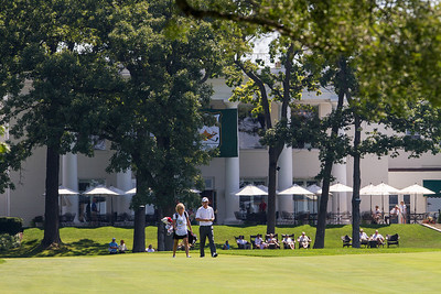 Player and caddy wok up the tenth fairway during first round medal play at the 2012 Western Amateur Championship at Exmoor Country Club in Highland Park IL. on Tuesday, July 31, 2012. (WGA Photo/Charles Cherney)