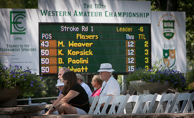 Spectators watch players tee off at the 10th hole during first round medal play at the 2012 Western Amateur Championship at Exmoor Country Club in Highland Park IL. on Tuesday, July 31, 2012. (WGA Photo/Charles Cherney)