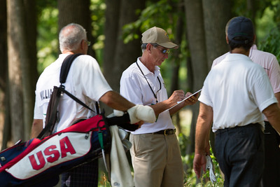 An Exmoor Club member takes scores after players leave the 6th green during first round medal play at the 2012 Western Amateur Championship at Exmoor Country Club in Highland Park IL. on Tuesday, July 31, 2012. (WGA Photo/Charles Cherney)
