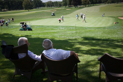 Spectators watch the actionon the 18th green during first round medal play at the 2012 Western Amateur Championship at Exmoor Country Club in Highland Park IL. on Tuesday, July 31, 2012. (WGA Photo/Charles Cherney)