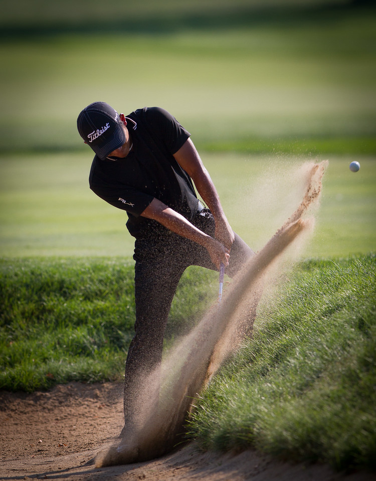 Cheng-Tsun Pan hits a bunker shot next to the 15th green during the final round round of medal play at the 2012 Western Amateur Championship at Exmoor Country Club in Highland Park IL. on Thursday, August 2, 2012.. (WGA Photo/Charles Cherney)