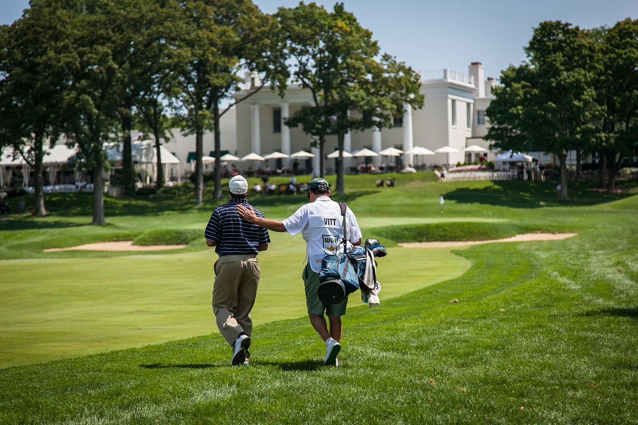 John Vitt who is caddying for his son Andrewpats him on the back as they walk up the 18th fairway, who is caddying for him during the second round medal play at the 2012 Western Amateur Championship at Exmoor Country Club in Highland Park IL. on Wednesday, August 1, 2012. (WGA Photo/Charles Cherney)