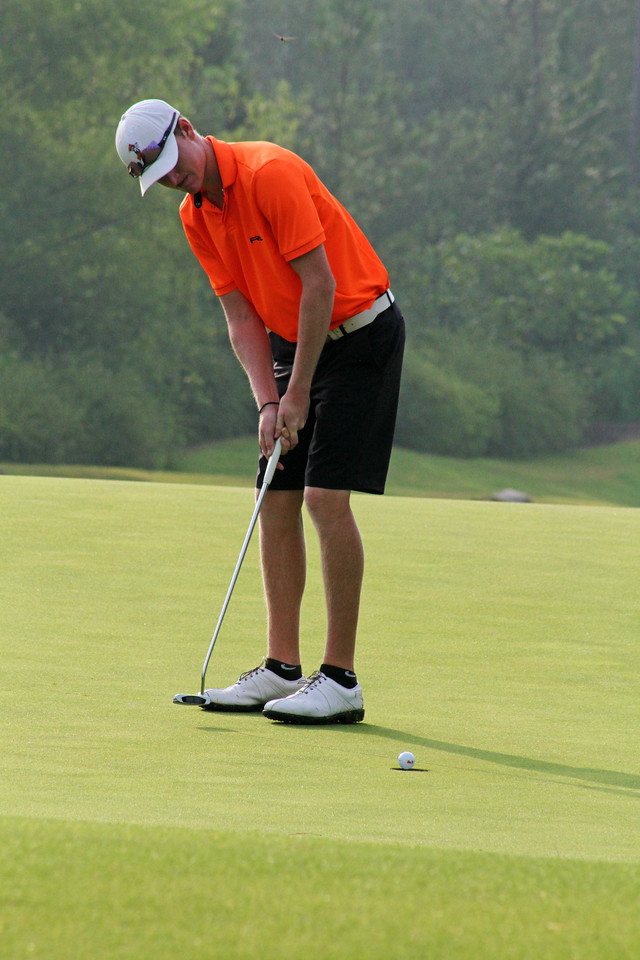 Jordan Niebrugge of Mequon, WI watches this putt hit the bottom of the cup during the championship match of the 111th Western Amateur at The Alotian Club in Roland, AR. (WGA Photo/Ian Yelton)