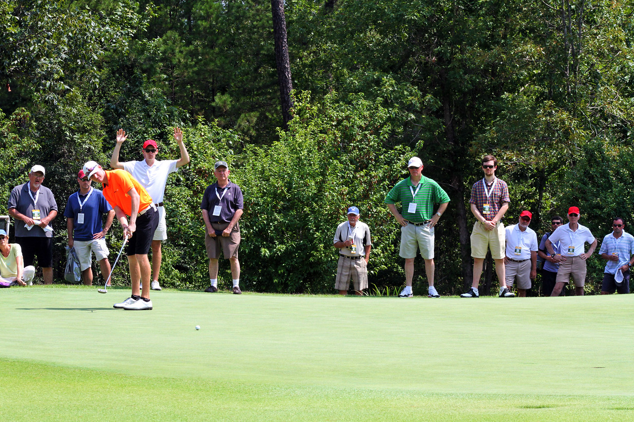 Jordan Niebrugge of Mequon, WI rolls a 50-foot putt (which he made) during the semifinals of the 111th Western Amateur at The Alotian Club in Roland, AR. (WGA Photo/Ian Yelton)