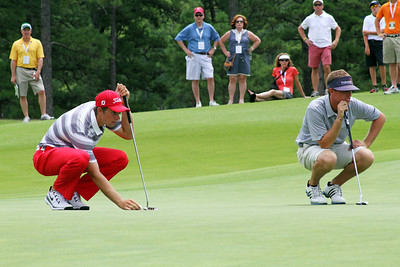 Patrick Rodgers of Avon, IN (left) and Sean Dale of Jacksonville, FL line up putts during the match play portion of the 111th Western Amateur at The Alotian Club in Roland, AR. (WGA Photo/Ian Yelton)