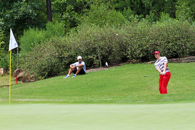 Patrick Rodgers of Avon, IN lofts a wedge towards the flag stick during the match play portion of the 111th Western Amateur at The Alotian Club in Roland, AR. (WGA Photo/Ian Yelton)