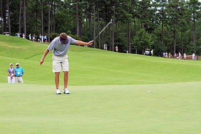 Sean Dale of Jacksonville, FL tells his putt what to do during the match play portion of the 111th Western Amateur at The Alotian Club in Roland, AR. (WGA Photo/Ian Yelton)