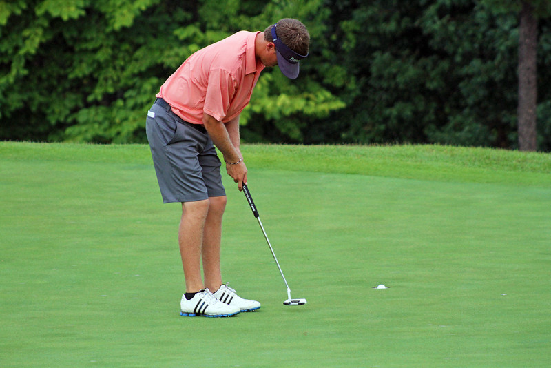 Sean Dale of Jacksonville, FL watches this putt hit the bottom of the cup during the championship match of the 111th Western Amateur at The Alotian Club in Roland, AR. (WGA Photo/Ian Yelton)