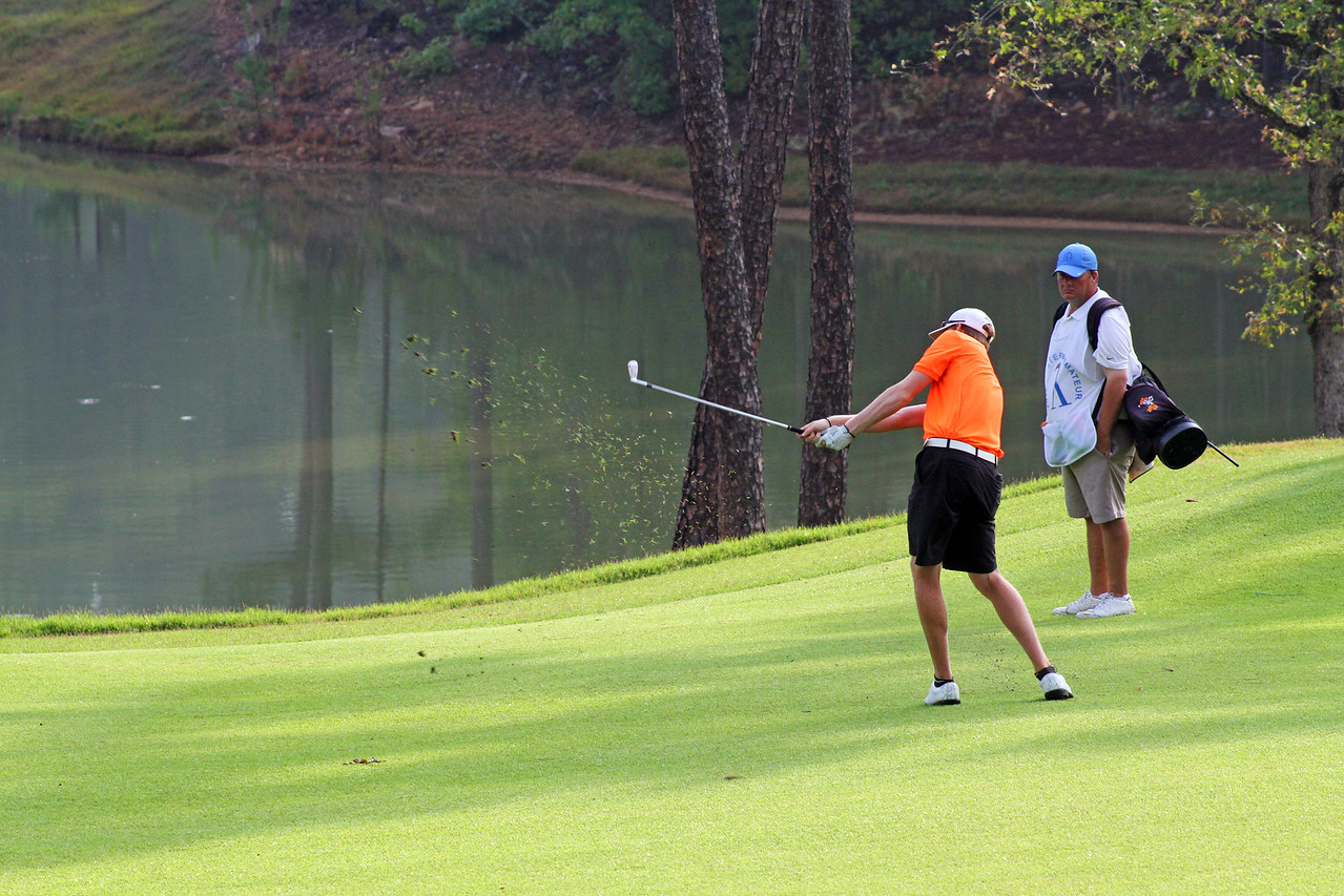 Jordan Niebrugge of Mequon, WI sprays a wedge towards the green as his caddie looks on during the championship match of the 111th Western Amateur at The Alotian Club in Roland, AR. (WGA Photo/Ian Yelton)