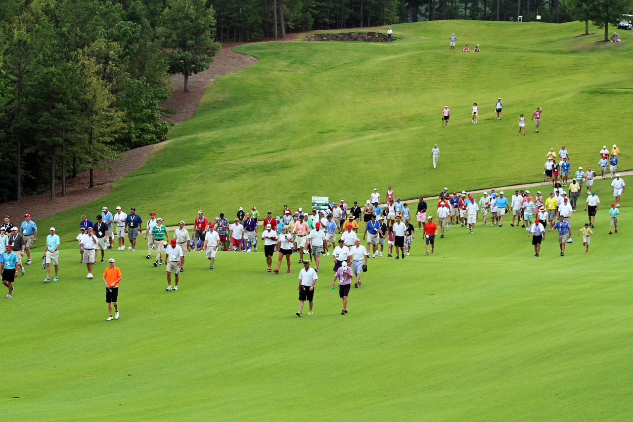 The gallery follows the championship match towards their shots in the fairway during the 111th Western Amateur at The Alotian Club in Roland, AR. (WGA Photo/Ian Yelton)