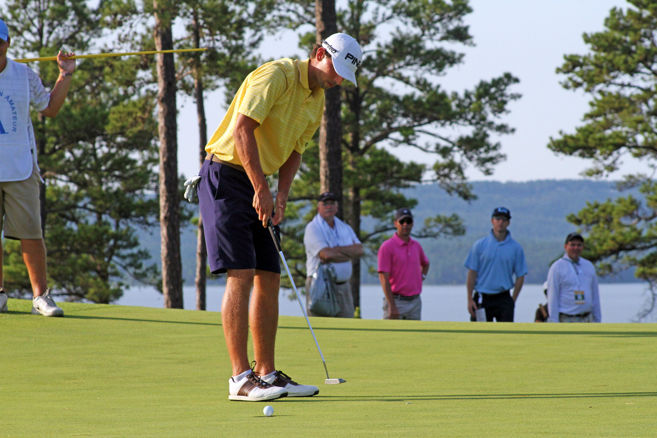 Seth Reeves of Suwanee, GA rolls in a short birdie putt during the quarterfinals of the 111th Western Amateur at The Alotian Club in Roland, AR. (WGA Photo/Ian Yelton)