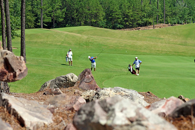 Andrew Yun of Chandler, AZ sends this approach towards the 18th green during his second round of the 2013 Western Amateur at The Alotian Club in Roland, AR. (WGA Photo/Ian Yelton)