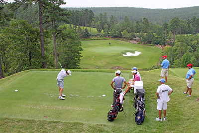 Nicholas Palladino of Highland Heights, OH sends his tee shot towards the 6th green during the first round of the 2013 Western Amateur at The Alotian Club in Roland, AR. The 6th hole features a dramatic 100 foot drop to the green and is one of many elevated teeing grounds that make up the Alotian Club. (WGA Photo/Ian Yelton)